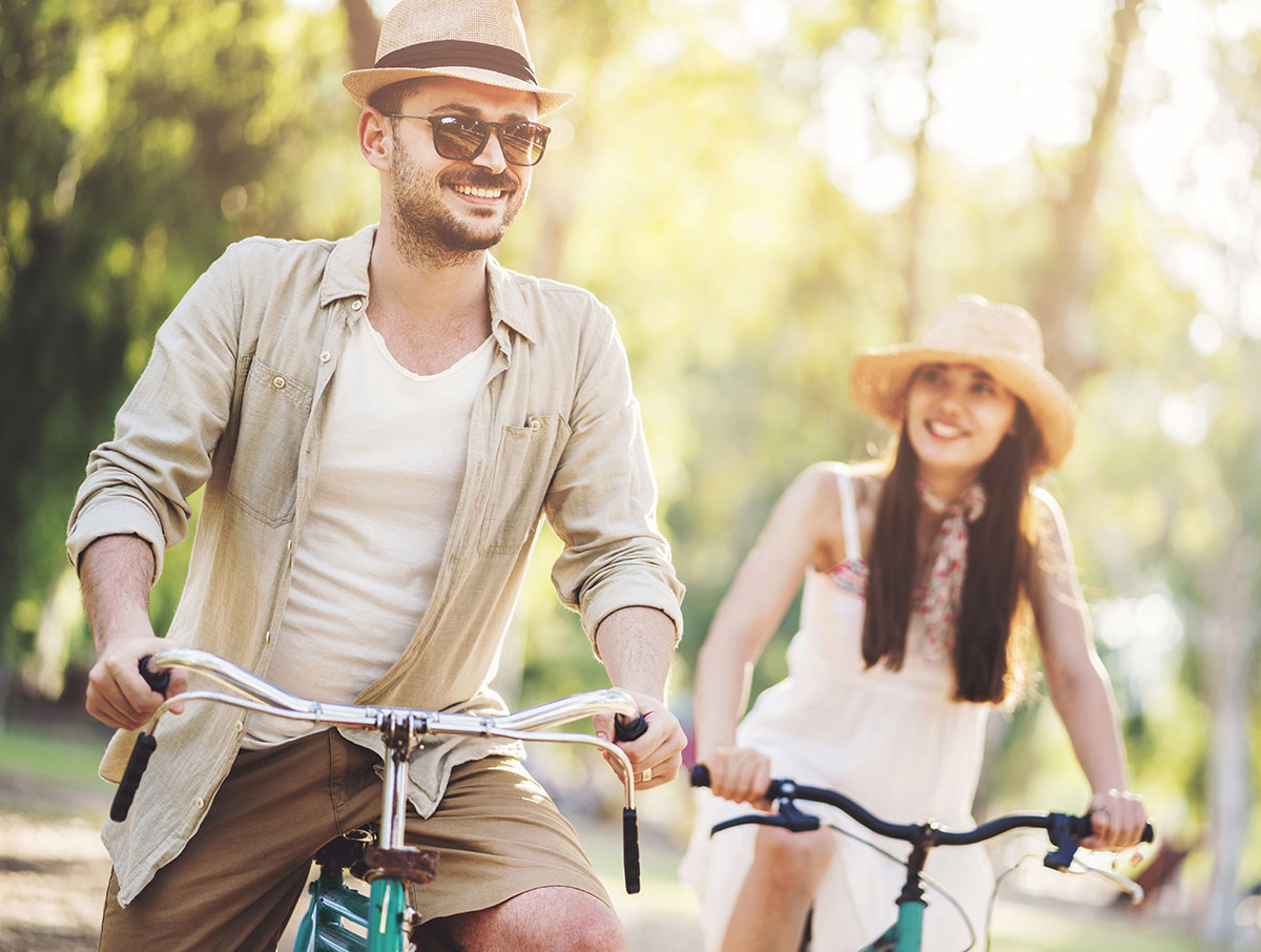 Young couple, biking, nature